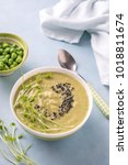 green pea soup in bowl with... | Shutterstock . vector #1018811674