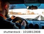 job driver. man drives a car in ... | Shutterstock . vector #1018812808