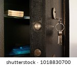 detail of open safe with bunch... | Shutterstock . vector #1018830700