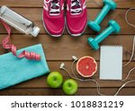 fitness concept with sneakers... | Shutterstock . vector #1018831219