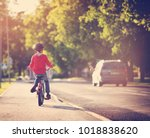 child on a bicycle at asphalt... | Shutterstock . vector #1018838620