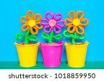 colorful plasticine flowers in...   Shutterstock . vector #1018859950