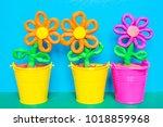 colorful plasticine flowers in...   Shutterstock . vector #1018859968