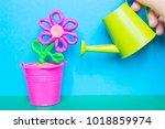 colorful plasticine flower in a ...   Shutterstock . vector #1018859974