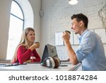 young man and woman sitting at... | Shutterstock . vector #1018874284