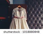 wedding dress hanging on the... | Shutterstock . vector #1018880848