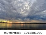 sunset on a lake | Shutterstock . vector #1018881070