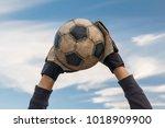 football goalkeeper catching... | Shutterstock . vector #1018909900