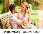 man fixes hair of his wife... | Shutterstock . vector #1018914850