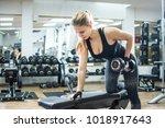 attractive fit blonde woman... | Shutterstock . vector #1018917643
