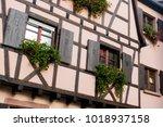 fragment of an orange facade of ... | Shutterstock . vector #1018937158