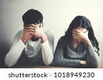 sad woman and man  sitting in... | Shutterstock . vector #1018949230