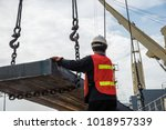 stevedore handle gang works on... | Shutterstock . vector #1018957339