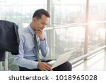 young businessman sitting and... | Shutterstock . vector #1018965028