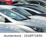 busy car park crowded... | Shutterstock . vector #1018971850