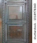 Small photo of Brown shiny wooden door with grey accumulated dust