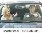 attractive happy mature woman... | Shutterstock . vector #1018982884