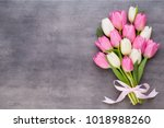 pink tulip and ribbon  pink eeg.... | Shutterstock . vector #1018988260