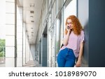 young happy redhead woman... | Shutterstock . vector #1018989070