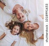 top view of little girl  her... | Shutterstock . vector #1018991653