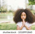 child praying. girl kid prays.... | Shutterstock . vector #1018991860