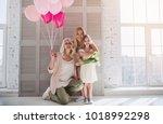 little cute girl  her... | Shutterstock . vector #1018992298