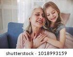 little cute girl and her... | Shutterstock . vector #1018993159