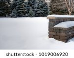 Stone Bench Covered In Snow In...