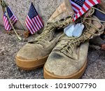 worn military boots with dog... | Shutterstock . vector #1019007790