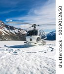 helicopter landing on snow... | Shutterstock . vector #1019012650