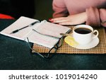 the glasses  notebook and hot... | Shutterstock . vector #1019014240