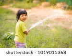 asian kid watering plant and... | Shutterstock . vector #1019015368