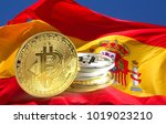 bitcoin coins on spain flag ...   Shutterstock . vector #1019023210