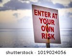 enter at your own risk sign  | Shutterstock . vector #1019024056