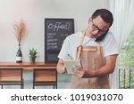 young asian man barista wear... | Shutterstock . vector #1019031070