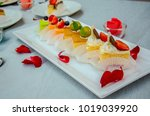 cake cut into pieces on the... | Shutterstock . vector #1019039920