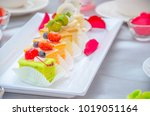 cake cut into pieces on the... | Shutterstock . vector #1019051164