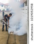 Small photo of Bangkok, Thailand - July 3, 2016 : Unidentified people fogging DDT spray for mosquito kill and protect by control mosquito is a carrier of Malaria, Encephalitis, Dengue and Zika virus in village.