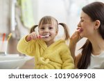 beautiful mother and kid... | Shutterstock . vector #1019069908