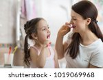 mother teaching kid daughter... | Shutterstock . vector #1019069968