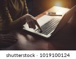 hands on the laptop keyboard.... | Shutterstock . vector #1019100124