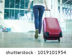 leg view of a woman in hurry... | Shutterstock . vector #1019101954