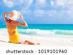 young girl in bright bikini... | Shutterstock . vector #1019101960