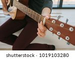 learning to play the guitar.... | Shutterstock . vector #1019103280
