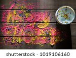 happy holi text written with... | Shutterstock . vector #1019106160