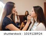 makeup artist creating... | Shutterstock . vector #1019128924