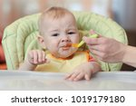cute baby refusing to eat food... | Shutterstock . vector #1019179180