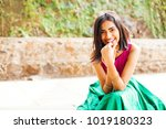 Stock photo beautiful indian woman smiling and looking at camera 1019180323