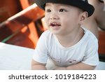 the asian boy in the wooden... | Shutterstock . vector #1019184223