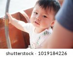 the asian boy in the wooden... | Shutterstock . vector #1019184226